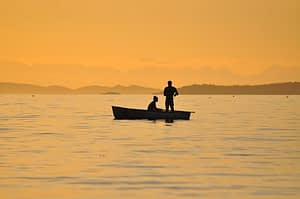 Couple riding a small boat