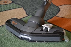Vacuum cleaner with a brush