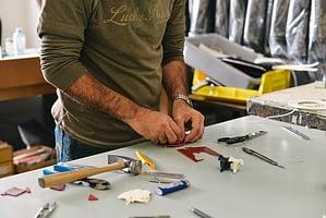 man fixing something using a hammer